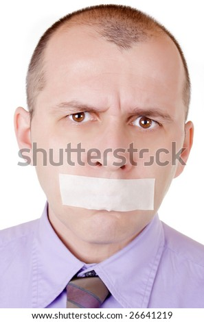 Portrait of a businessman with taped mouth on white background