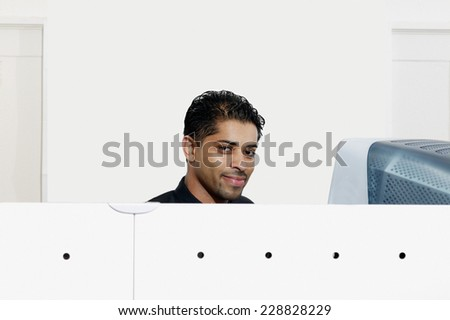 Portrait of a businessman working in office setting - stock photo
