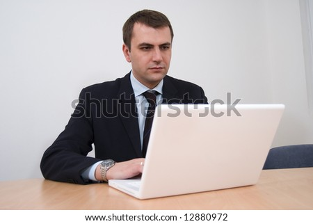 Portrait of a businessman working on laptop