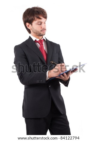 Portrait of a businessman writing something
