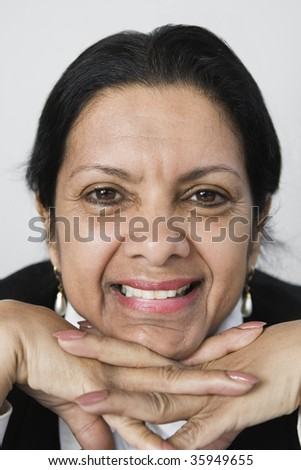 Portrait of a businesswoman against white background. - stock photo