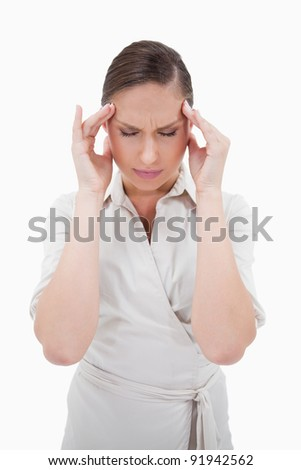 Portrait of a businesswoman having a headache against a white background