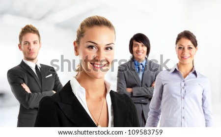 Portrait of a businesswoman in front of her team