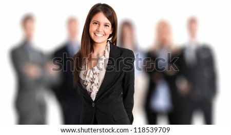 Portrait of a businesswoman in front of her team - stock photo