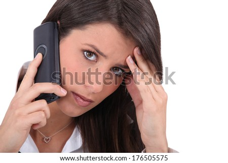 portrait of a businesswoman on the phone - stock photo