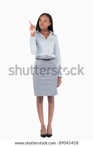 Portrait of a businesswoman pointing at a copy space against a white background - stock photo