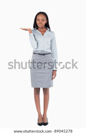 Portrait of a businesswoman presenting something against a white background - stock photo