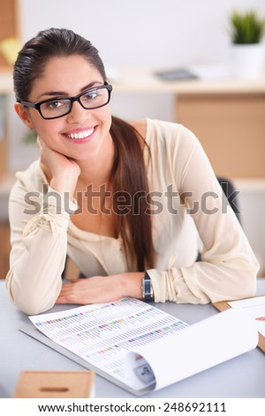 Portrait of a businesswoman sitting at a desk with a laptop