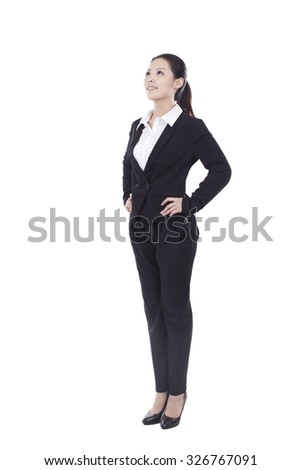 Portrait of a businesswoman standing in a suit - stock photo