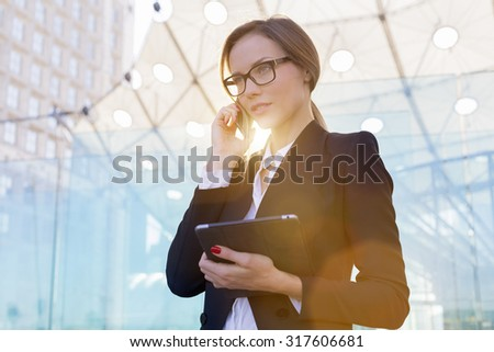 Portrait of a businesswoman talking on mobile phone - stock photo