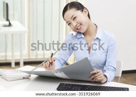 Portrait of a businesswoman using telephone