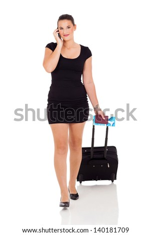 portrait of a businesswoman with a suitcase making a phone call against a white background - stock photo
