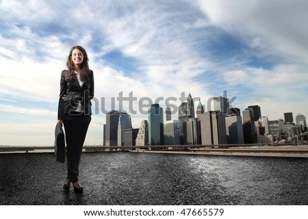 Portrait of a businesswoman with cityscape on the background - stock photo