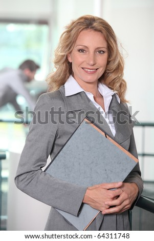Portrait of a businesswoman with documents