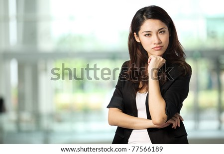 Portrait of a Businesswoman with her arms crossed - stock photo