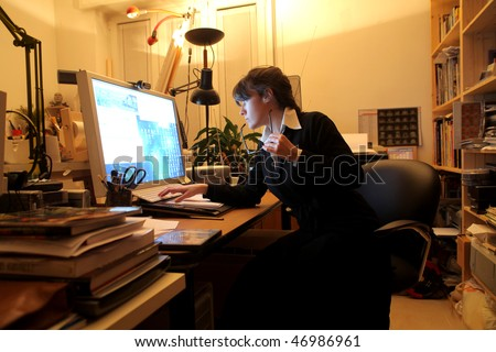 Portrait of a businesswoman working on a computer in a studio