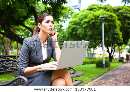 Portrait of a businesswoman working outdoors on laptop