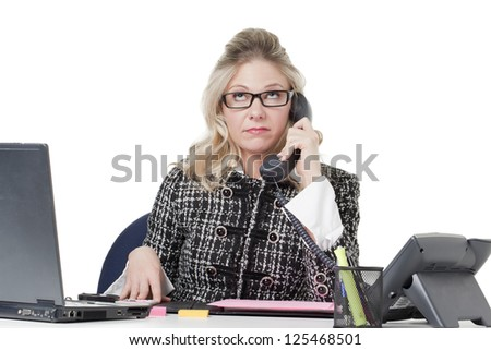 Portrait of a busy office secretary attending to the telephone - stock photo