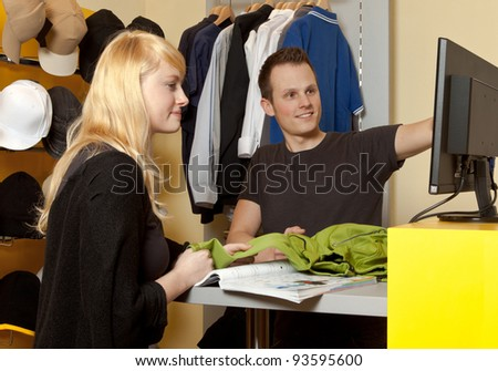 Portrait of a buyer and a Young Man in her clothing store - stock photo
