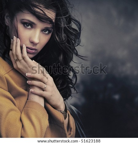 Portrait of a calm young woman - stock photo