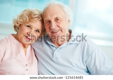 Portrait of a candid senior couple enjoying their retirement - stock photo