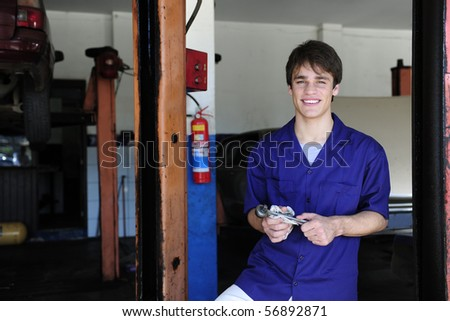 portrait of a car mechanic at work with copy space - stock photo