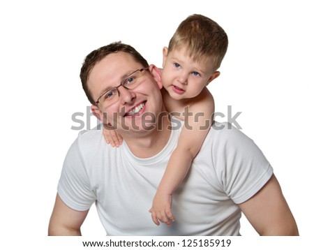 Portrait of a caring young father giving his son piggyback ride against white background - stock photo