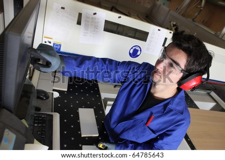 Portrait of a carpenter in workshop - stock photo