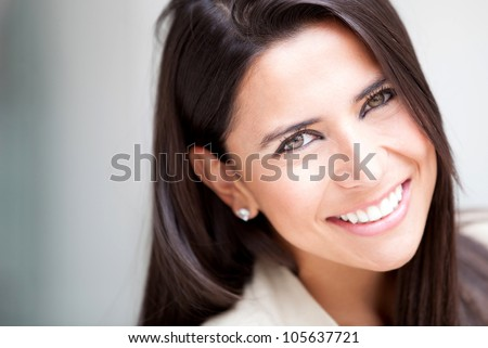Portrait of a casual businesswoman looking happy - stock photo