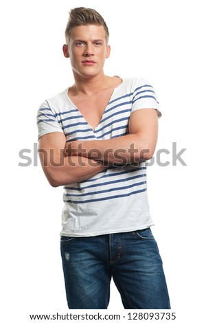 Portrait of a casual guy with arms crossed - stock photo