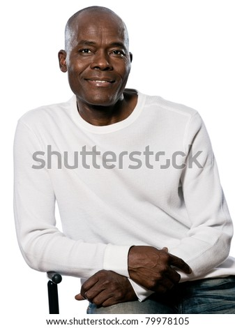 Portrait of a casual handsome afro American man smiling while sitting in studio on white isolated background - stock photo