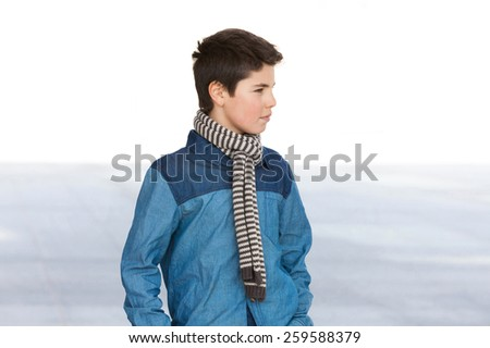 portrait of a casual teen boy, outdoors - stock photo