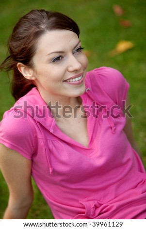 Portrait of a casual woman outdoors smiling - stock photo