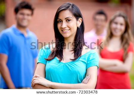 Portrait of a casual woman smiling outdoors - stock photo