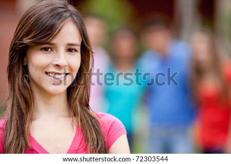 Portrait of a casual woman smiling outdoors