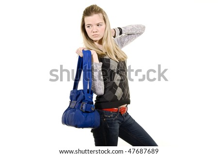 Portrait of a casual woman with handbag. blue leather - stock photo
