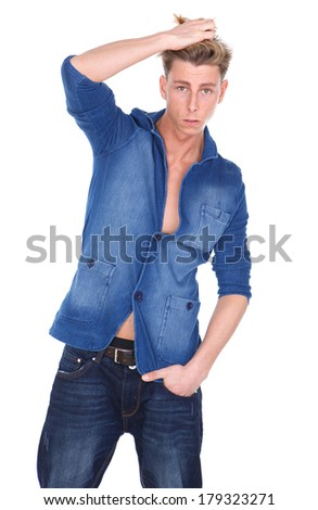 Portrait of a casual young guy standing with hand in hair on isolated white background