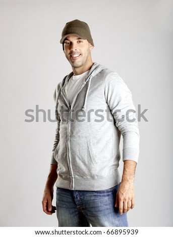 Portrait of a casual young man isolated on a gray background