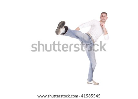 Portrait of a casual young man smiling on white background - stock photo