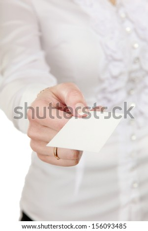 Portrait of a casual young woman holding blank card - on white background..