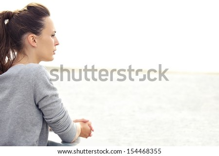 Portrait of a caucasian active woman alone thinking and looking away. Copy space right. - stock photo