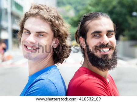 Portrait of a caucasian guy with arabian friend - stock photo