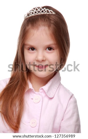 Portrait of a caucasian little fashion girl with tiara on her head on Holiday theme - stock photo