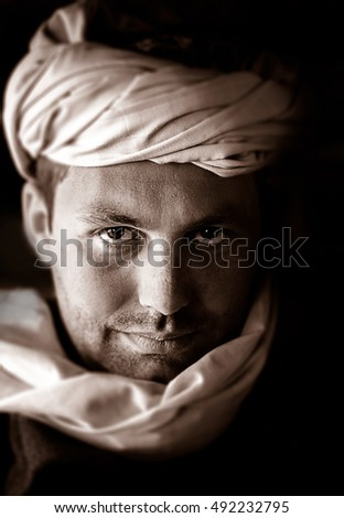 Portrait of a caucasian man wearing a beduin scarf