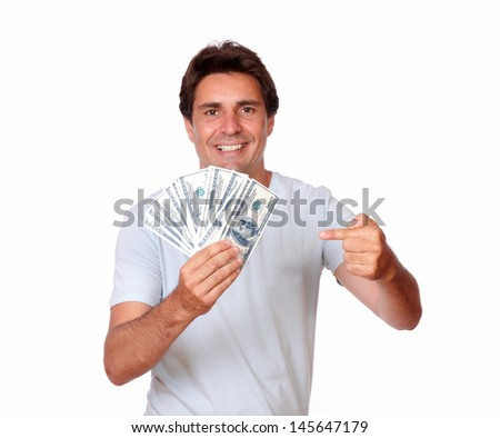 Portrait of a charismatic latin male holding cash money in isolated background