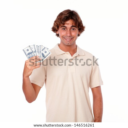 Portrait of a charismatic young man holding cash money on white background