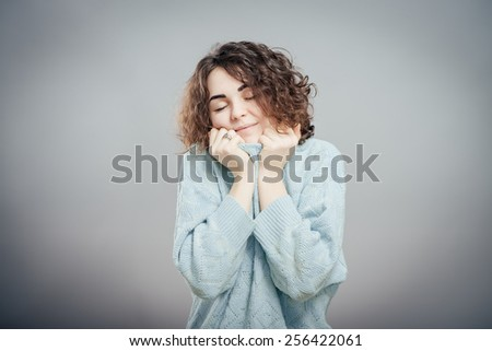 portrait of a charming attractive young dark-haired woman in a  sweater - stock photo