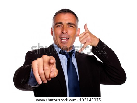 Portrait of a charming business man pointing and conversing against white background - stock photo