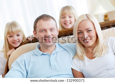 Portrait of a charming couple having twin kids
