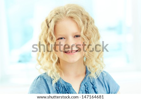 Portrait of a charming girl smiling at camera - stock photo
